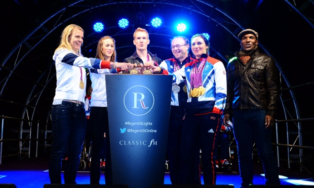 Three, two, one ... Members of the Olympic and Paralympic teams and Noah Stewart switch on the Regent Street Christmas Lights in London. Photograph: Ian West/PA