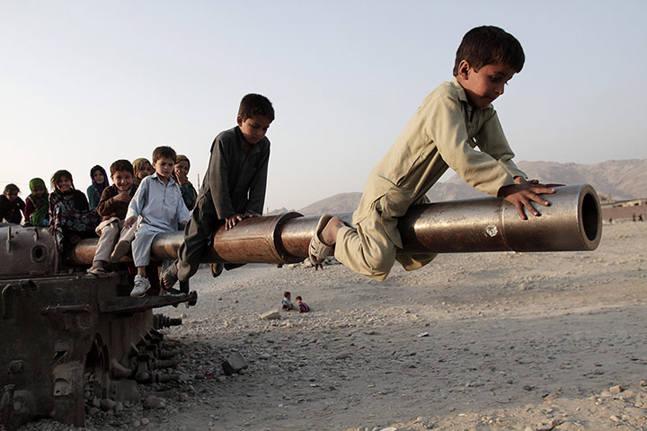 24 hours in pictures: Afghan children play on a damaged Soviet tank