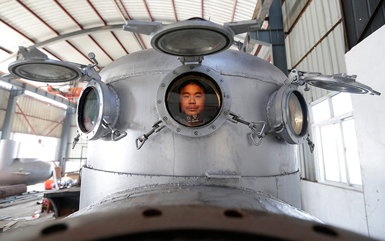 24 hours in pictures: Zhang Wuyi sits in his submarine
