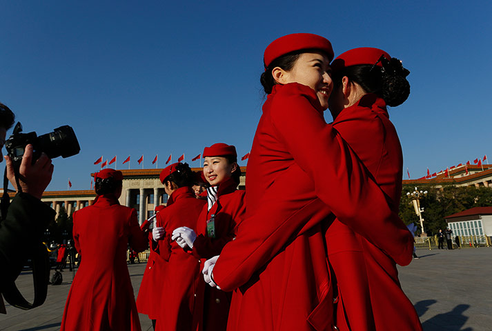 24 hours in pictures: Hostesses for the National Congress, Beijing