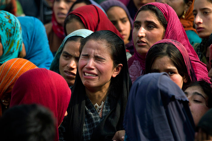 24 hours in pictures: Kashmiri villagers grieve during a funeral