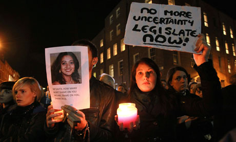 Irish protesters hold pictures of Savita Halappanavar who died after being refused an abortion