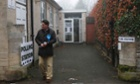 A Conservative party teller waits outside a polling station on a foggy morning in Oundle, near Corby where there is a by-election today.