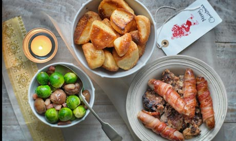 Pigs in blankets, roast potatoes and vegetables