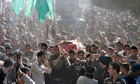 Hamas military commander Ahmed al-Jabari being carried to his funeral on Thursday