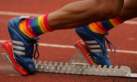 A runner with his feet in the starting blocks