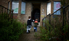Children playing near boarded up houses