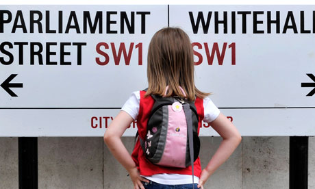 Child looking at a sign for Whitehall