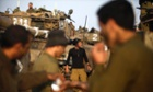 Israeli soldiers wake after sleeping in a deployment area on 19 November 2012 on Israel's border with the Gaza Strip. Photograph: Lior Mizrahi/Getty Images