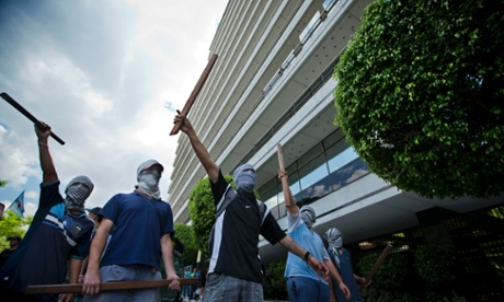 Genetically modified protest: Masked protestors shout slogans against the U.S.-based Monsanto company outside its offices in Buenos Aires, Argentina. The protest was held against copyrighted seeds, the use of soy as a mono-culture and the dominant presence of Monsanto in Argentina.