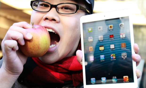 Koudai Taguchi bites an apple (geddit?) as he shows off his newly purchased iPad mini in front of the Apple Store in Ginza, Tokyo this morning.