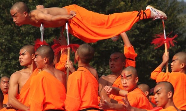 And your point is? Shaolin monks perform qigong, a type of traditional Chinese martial arts, during the opening ceremony of the fourth Southern Shaolin Martial Arts Cultural Festival in Putian city, Fujian province.