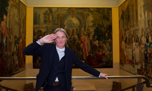Suits you, sir: Paul Smith poses for photographs during a textile conference at the Clothworkers Hall in London. Smith was joined by the business secretary, Vince Cable, during a conference to encourage UK retailers to buy British textiles. Photograph: Facundo Arrizabalaga/EPA
