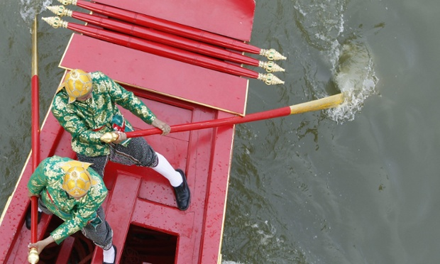 Thai Royal Navy oarsmen in ancient warrior costumes during rehearsals of the Royal Barge Procession for Royal Kathin Ceremony at Chao Phraya river in Bangkok, Thailand.