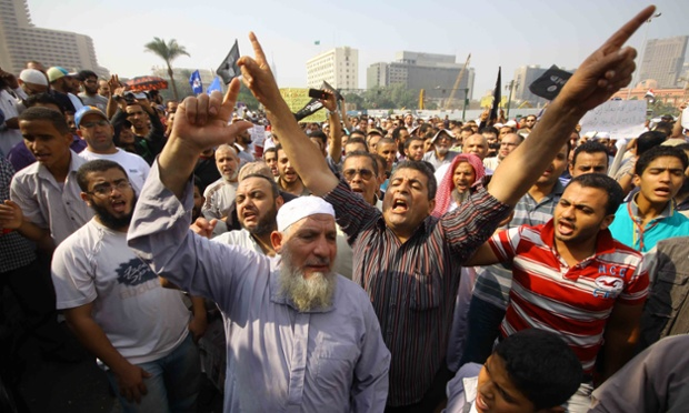 Egyptian Salafists in Cairo's Tahrir Square shout slogans during a demonstration demanding the implementation of sharia law. Photograph: AFP/Getty Images