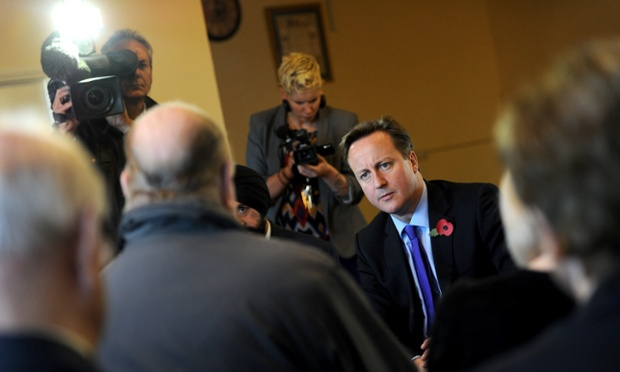 Listening to the people: David Cameron speaks with local residents during a visit to the W.I. Hall in Arlesey, Bedfordshire, as part of the Conservative Party's upcoming police and crime commissioner elections campaign.