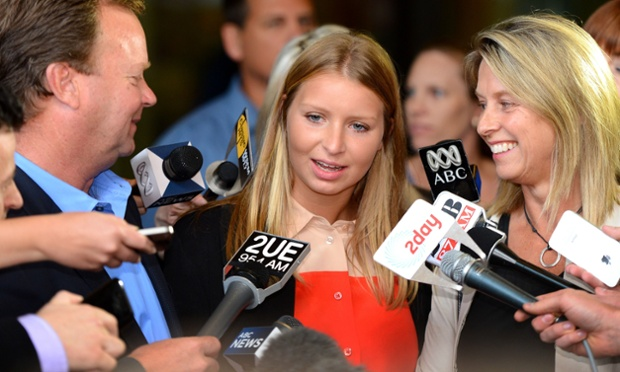 Standing between her mother and father, Madeleine Pulver speaks to the media in Sydney.  Paul Peters, an investment banker has been sentenced to 13 years in prison after attaching a fake collar bomb around Madeleine's neck in a bizarre attempt to extort money from her family.