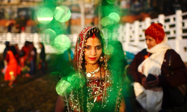 A woman in traditional dress takes part in the 'Chhat' festival in Kathmandu. Hindus in Nepal are celebrating the four-day festival that honors the sun god, by praying at sunrise and sunset and giving offerings to seek blessings for their families.