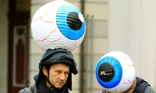 The eyes have it! Protestors wearing eyeballs are photographed during a demonstration outside Glencore's extraordinary shareholder meeting in the Swiss town of Zug. Shareholders in miner Xstrata are expected to give the green light today to a takeover by commodities giant Glencore.