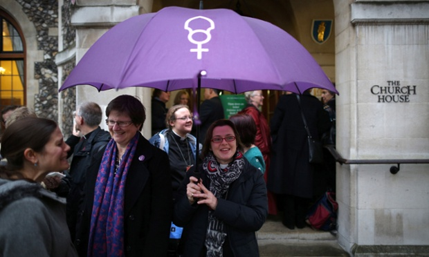 Women clergy gather with others to enter the public gallery at Church House in London this morning. The Church of England's governing body, known as the General Synod, will later today vote on whether to allow women to become bishops.
