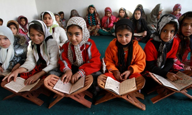 Children learn to read the Koran at a seminary in Herat, Afghanistan. Despite the Afghan government's significant efforts in recent years, many people remain illiterate.