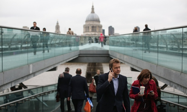 It's a bleak day as people cross Millennium Bridge on their way to work in London but things are looking up - the latest unemployment figures published by the Office for National Statistics calculated 2.51 million people are out of work, which is the lowest level of joblessness for over a year.