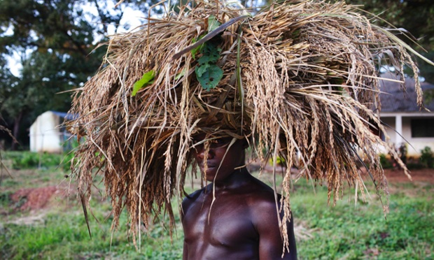 A farmer carries wheat on his head to striking effect as he walks home after a day's work in Guiledge, Guinea-Bissau. The photographer took the portrait while documenting agriculture in the region.