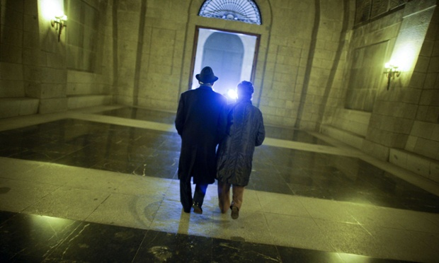 A couple leave after attending a mass to commemorate the anniversary of the death of Spain's former dictator General Franco in the Valle de los Caidos near Madrid, where his tomb lies.