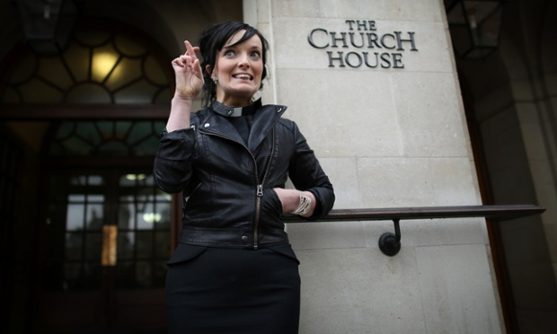 Fingers crossed, Reverend Sally Hitchiner is photographed during a lunch break outside Church House in London where the General Synod will vote today on whether to allow women to become bishops.