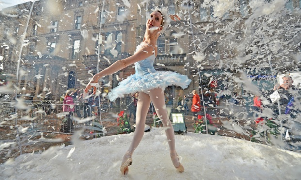 In a blizzard of snowflakes, Claire Robertson from the Scottish Ballet poses inside a huge snow globe on Buchanan Street in Glasgow during a promotion for the Scottish Ballet's festive production of The Nutcracker. The show opens at the Theatre Royal on 8 December.