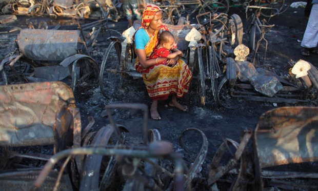 Taslima Akhter sits with her six-month-old daughter Fatema among burnt remains in a slum after a fire in Dhaka, Bangladesh. Thousands of people were left without shelter following the fire, which killed at least 14 people and destroyed 500 homes.