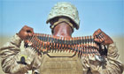 A US Marine removes a bandolier of ammun