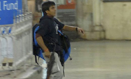 Mohammad Ajmal Kasab during his armed rampage at a train station as part of the Mumbai attacks