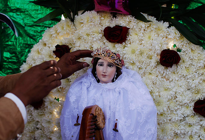 24 hours in pictures: A mariachi arranges the crown of Saint Cecilia