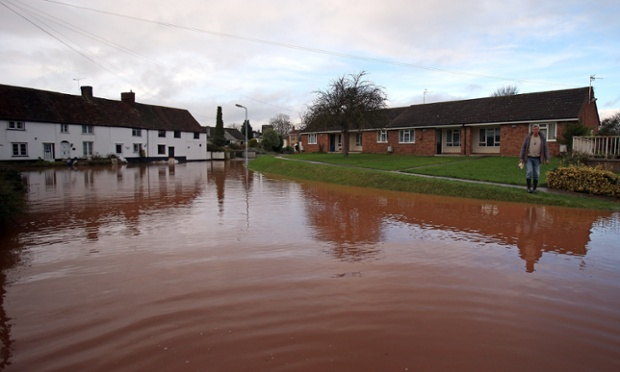 Flood water continues to block the main road through the centre of the village of Ruishton, near Taunton.