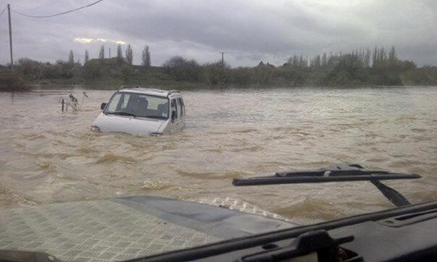 The dramatic moments when David and his son Cameron drove their Landrover into the flood to rescue a pensioner after spotting the elderly man floating down the swollen river in his car. The man was wet and shaken but otherwise unhurt.