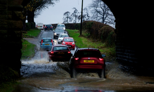 Vehicles attempt to traverse floodwater on a diversion route at Bishop Monkton near Ripon, North Yorkshire. Drivers were diverted down the minor lanes aftepolice closed the main A61 trunk road.