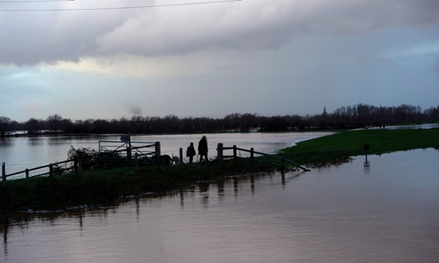 People walk across flooded fields near North Curry, Somerset.