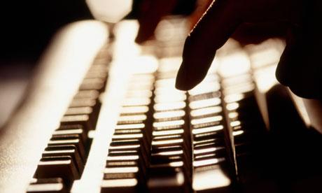 Women typing on computer keyboard