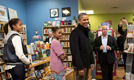 Barack Obama in a bookshop with his daughters