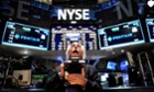 Traders work on the floor of the New York Stock Exchange (NYSE) before the Closing Bell in New York, US. The Dow Jones Industrial Average fell 42.31 points, or 0.33 per cent, to close at 12967.37.