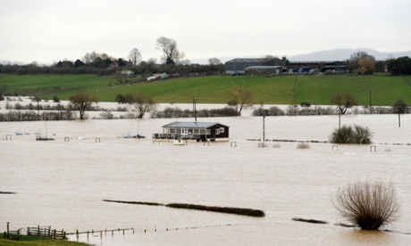 A property surrounded by floodwater next to the River Severn in Tewkesbury, Gloucestershire, on 27 November 2012.
