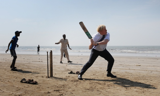 London Mayor Boris Johnson swings into action  with a local Mumbai school cricket team on Juhu Beach in India. The Mayor is in Mumbai as part of a week long tour of India where he is trying to persuade Indian businesses to invest in London.