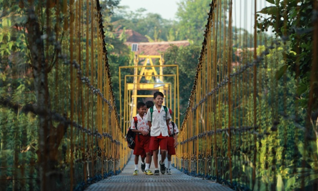 Now for a good news story. These children are enjoying their walk across a new bridge over a river to get to school at Sanghiang Tanjung village in Lebak, Indonesia. The bridge has replaced one that was damaged after flooding in January that left the students with a treacherous daily journey.