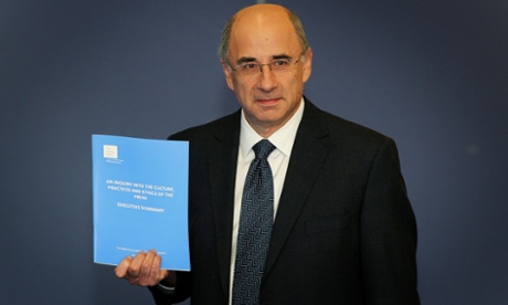 Lord Justice Leveson with the report.