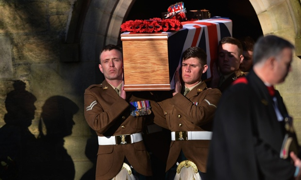 Soldiers carry the coffin of Captain Walter Barrie, from The Royal Scots Borderers, 1st Battalion the Royal Regiment of Scotland out of Glencorse Kirk in Penicuik, Scotland. Captain Barrie was shot by a member of the Afghan Army in Afghanistan while taking part in a football match between British soldiers and members of the Afghan National Army at Forward Operating Base Shawqat in Helmand province.