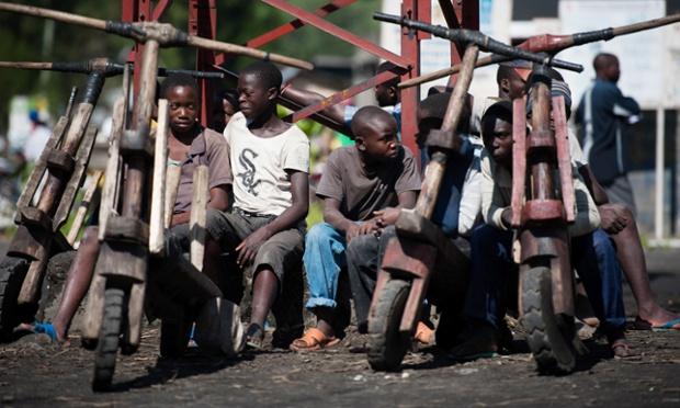 Congolese children sit next to their