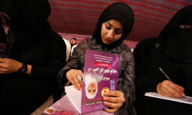 Supporters of Mona Ghareeb, a female Shi'ite candidate for parliament, take notes during her last campaign meeting in Kuwait City.