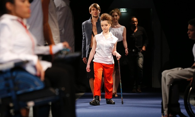 Models present creations by French designer Chris Ambraisse Boston at a catwalk show for his ready-to-wear fashion collection for disabled people in Paris.