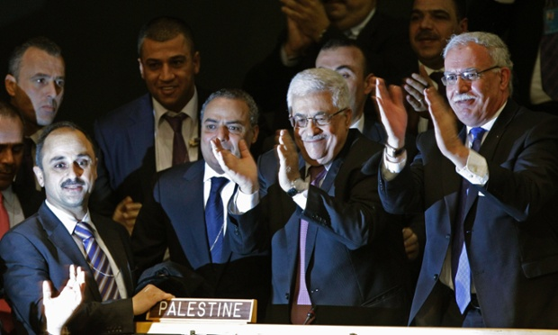 Members of the Palestinian delegation and others join Mahmoud Abbas by applauding after the vote was passed.